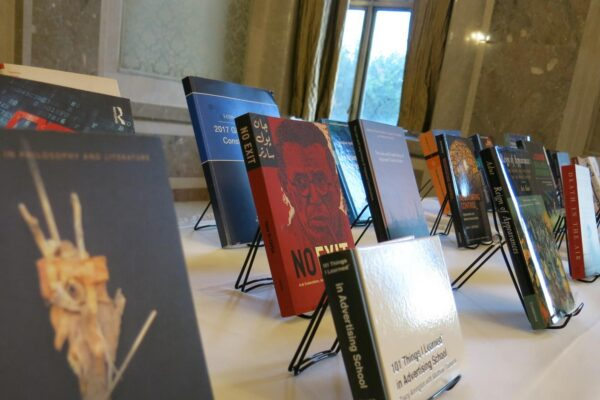 books on display at faculty author's reception