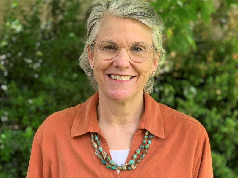 Carolyn Connerat in burnt orange blouse